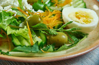 Spring salad with herbs, vegetables and eggs