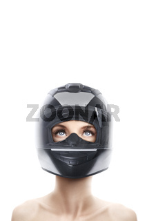 Portrait of young beautiful woman in motorcycle helmet isolated over white background with copy space above