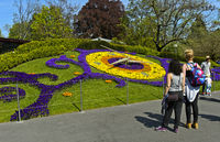 Tourists regarding the flower clock,  at the park Jardin Anglais, Geneva, Switzerland