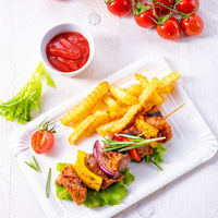 shish kebab skewers with marinated ham meat paprika and red onion