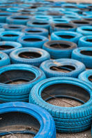 Blue disused tyres on the ground