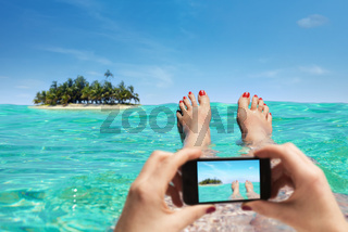 Woman is taking a picture on vacation with the smartphone