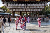 KYOTO, JAPAN - 08 FEB 2018: Colorful young japanese girls dressed in traditional kimonos chatting in temple