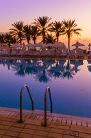 Swimming pool on Cyprus island at sunset