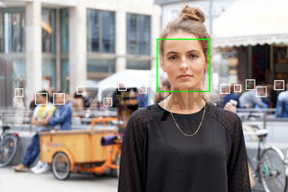 young woman picked out by face detection or facial recognition software