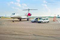 Airplane and cars at runway