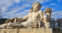 Paris, France - March 28, 2017: A statue of the Colossus Nile in the Jardin des Tuileries in Paris against a bright blue sky with white clouds, France