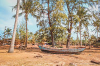 old wooden fisher boat on land , vintage fisherboat near beach -