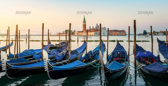 Moored Gondolas at venetian sunrise