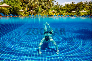 Man under water in a swimming pool