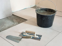 Tools and Adhesive for Laying of Ceramic Tiles.