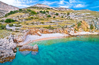 Island of Krk idyllic pebble beach with karst landscape, stone deserts of Stara Baska,