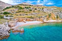 Island of Krk idyllic pebble beach with karst landscape, stone deserts of Stara Baska,