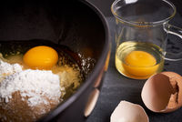 Mixing Bowl and Glass with Eggs, Flour and Sugar
