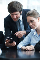 Business people using smartphone