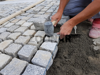Worker Arranging a Pavement