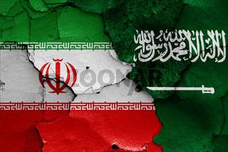 flags of Iran and Saudi Arabia painted on cracked wall