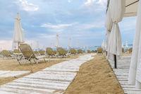 Chairs and umbrellas on a beautiful beach at Sunny Beach on the Black Sea coast of Bulgaria