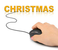 Hand with computer mouse and Christmas