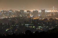 Oakland and San Francisco Cityscapes on a Hazy Summer Night.