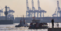 Ship tugs and excursion ship drive up the Elbe in the Hamburg harbor Container terminal Burchardkai