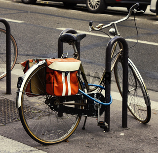 bike is fastened to rack of street fence