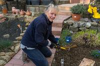 Gardener working in a flower bed.