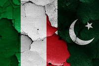 flags of Italy and Pakistan painted on cracked wall