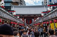 TOKYO, JAPAN - 13 FEB 2018: Tourists and locals walking in Senso-ji temple market street facing to the lanternt at the entrance
