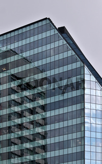 Building is reflected in a glazed modern building office center