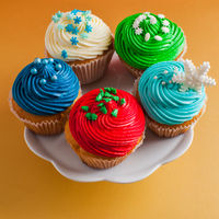Christmas clolouurfull cupcakes, decorated with sweet sugar