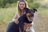 Pretty blond woman with her two dogs