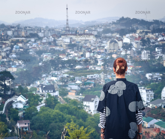 Woman overlooking the city view, Dalat, Vietnam