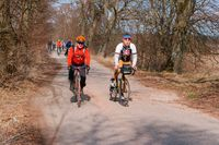 cycling in early spring, cyclists outside the city