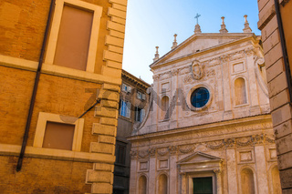 View on the ancient buildings and a church in Rome