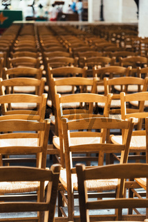 Empty chairs inside a church forming a pattern