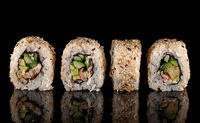 Several sushi california rolls in a row