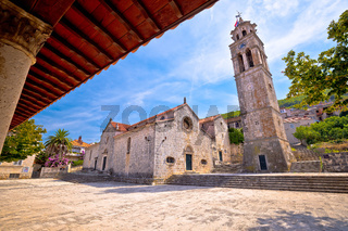 Blato on Korcula island historic stone square town lodge and church view