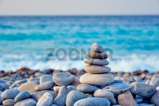 Zen balanced stones stack on beach