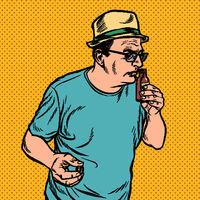 a man sniffs a bottle. perfume or medicine