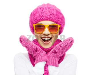 happy teenage girl in winter hat and sunglasses