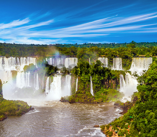 Powerful waterfall creates rainbow
