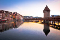 Luzern wooden Chapel Bridge and tower dawn view