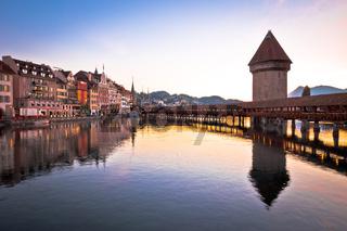 Luzern wooden Chapel Bridge and tower dawn view