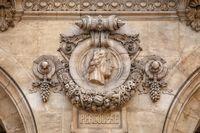 Paris, France, March 31, 2017: Architectural details of Opera National de Paris: Percolese Facade sculpture. Grand Opera is famous neo-baroque building in Paris, France - UNESCO World Heritage Site