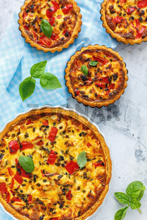 Homemade quiche with chicken, onions and pepper.