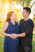 Hispanic Pregnant Young Couple Portrait Outdoors