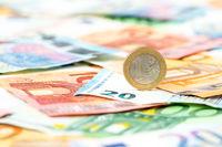 Euro coin on euro background