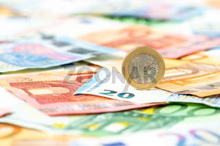 Euro coin on euro background