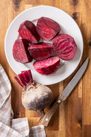 Sliced tasty raw beetroot and knife.